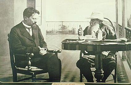 both men seated, black and white photo
